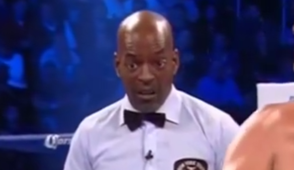 The look on this referee, he knows this guy is going down!