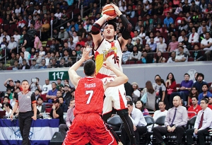 June Mar Fajardo shooting over Sonny Thoss